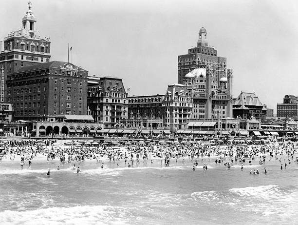 Crowded Beach, With Ocean In The Foreground. Swimmers,...