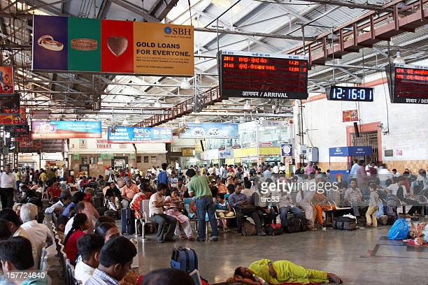 Crowded booking office concourse at Mumbai Railway Station