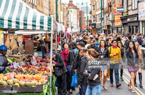 crowded brick lane, london - east london stock pictures, royalty-free photos & images
