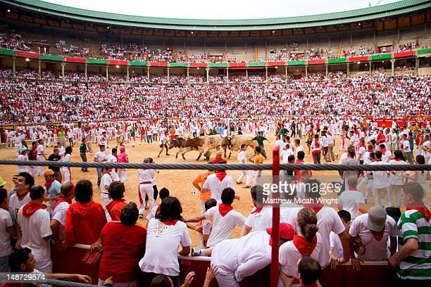 Crowded bullring during San Fermin festival.
