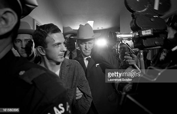 Crowded by police and members of the press the accused assassin of President John F Kennedy Lee Harvey Oswald is taken down the hall on the second...