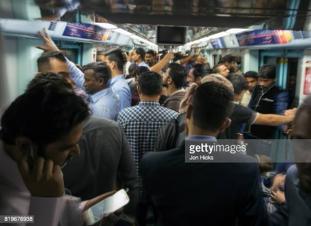 A crowded carriage during rush hour on the Dubai Metro.