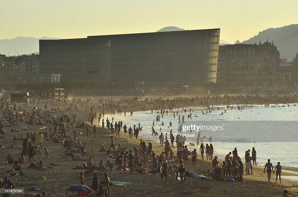 Crowded city beach in a well-known Spanish resort : Stock Photo