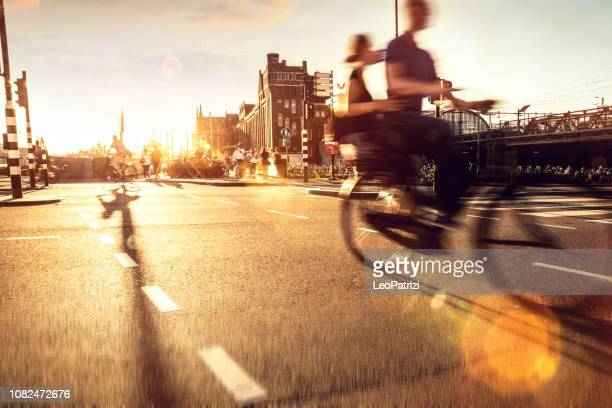 crowded city street cyclists and pedestrians - north holland stock pictures, royalty-free photos & images