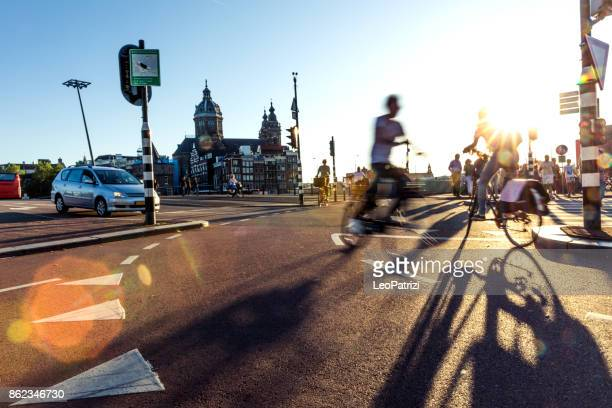 crowded city street cyclists and pedestrians - traffic stock pictures, royalty-free photos & images