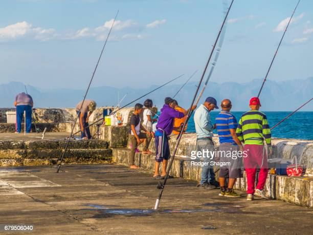 crowded fishing sport - day of the week stock pictures, royalty-free photos & images