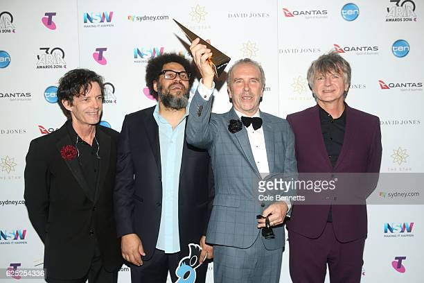 Crowded House pose in the awards room with an ARIA after being inducted into the ARIA Hall of Fame during the 30th Annual ARIA Awards 2016 at The...