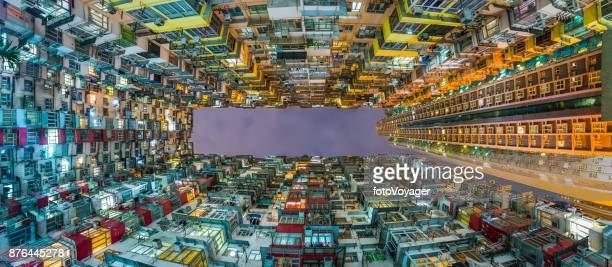 Crowded housing illuminated apartment block urban panorama Hong Kong China