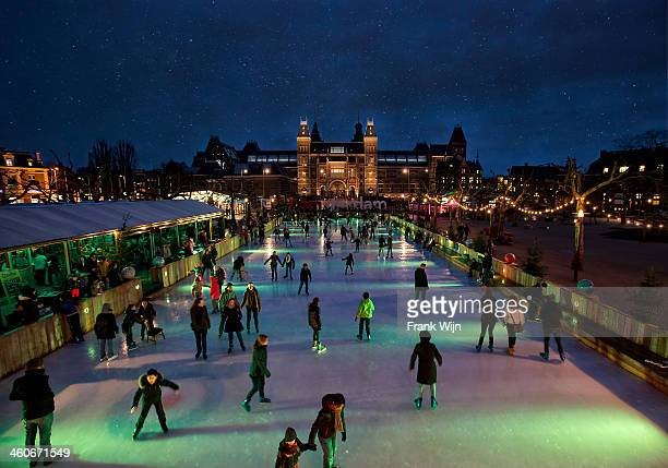 CONTENT] Crowded ice skating rink with starry sky at night Museumplein Amsterdam In front of the Rijksmuseum