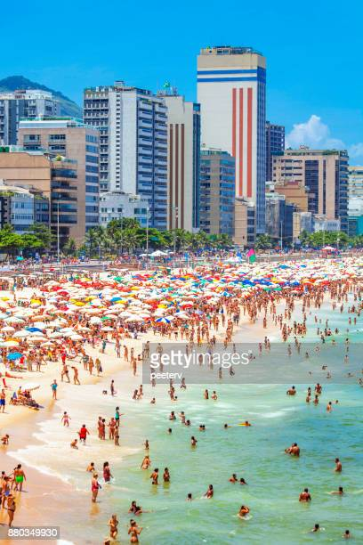 crowded ipanema beach - rio de janeiro, brazil - crowded beach stock pictures, royalty-free photos & images