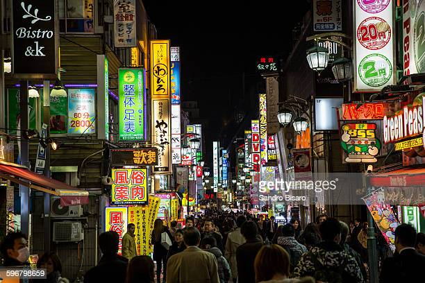 Crowded Japanese street with neon lights