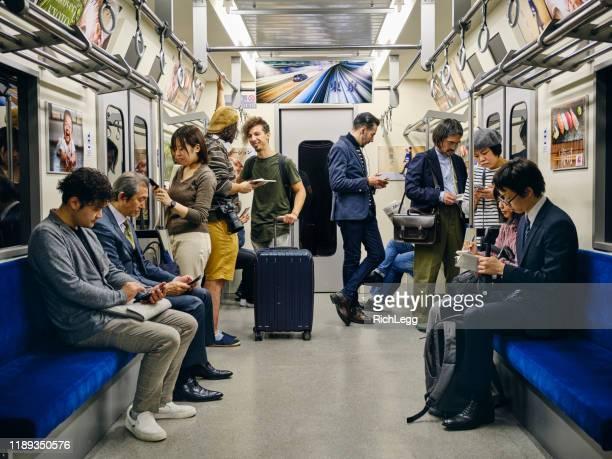 crowded japanese subway train - dentro imagens e fotografias de stock