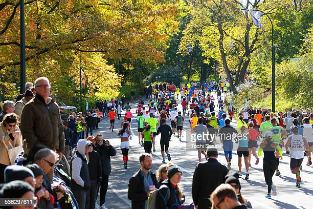 Crowded marathon runners and audience at autumn.
