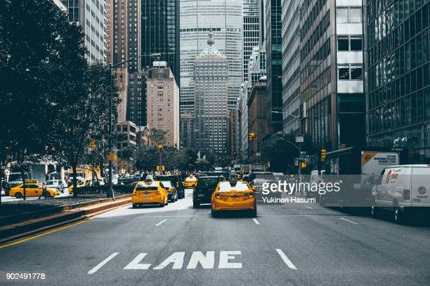 crowded midtown street - new york skyline stock photos and pictures