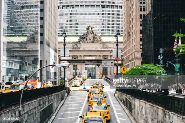 crowded midtown street - grand central station stock photos and pictures