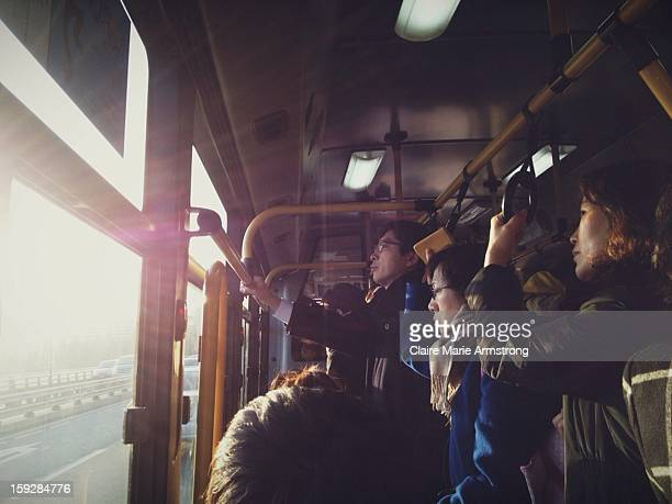 CONTENT] A crowded morning bus ride crossing the Han River in Seoul South Korea