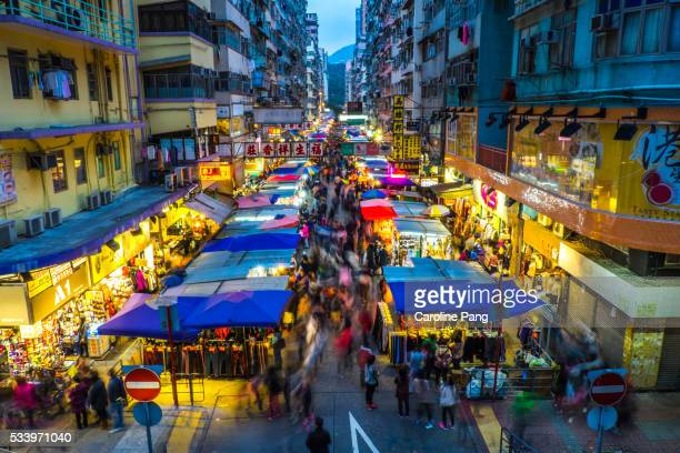 crowded night market, mongkok, kowloon, hong kong - kowloon peninsula stock pictures, royalty-free photos & images