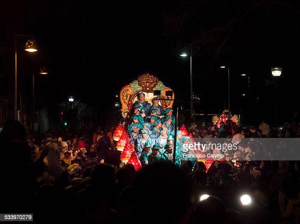 Crowded night parade celebrating the Three Kings day Terrassa Barcelona province Spain