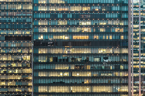 Crowded Office Buildings at Night - gettyimageskorea