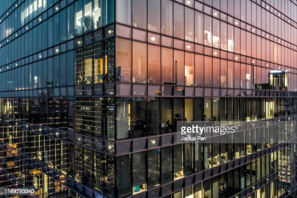 crowded office buildings at twilight - business finance and industry fotografías e imágenes de stock