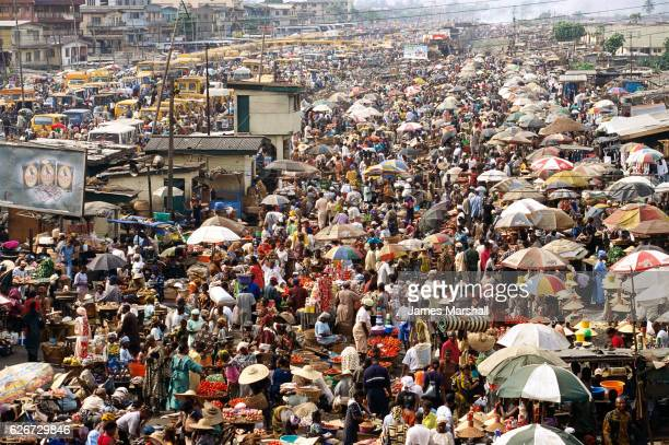 crowded oshodi market in nigeria - lagos nigeria stock pictures, royalty-free photos & images