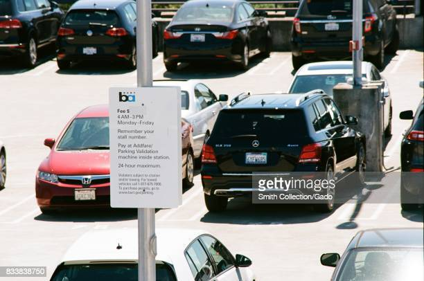 Crowded parking lot for the Bay Area Rapid Transit system at the Pleasant Hill California station with BART logo and signage visible July 26 2017