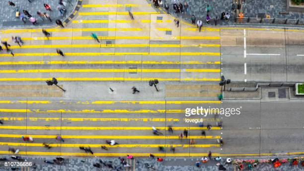 crowded people on road intersection in modern city