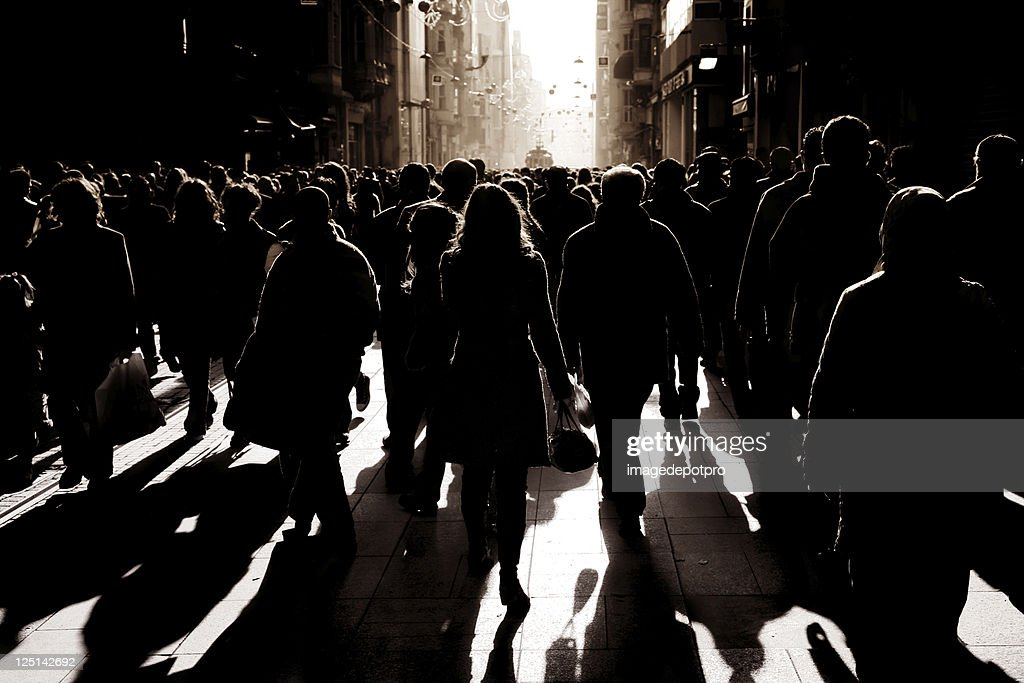 crowded people walking on busy street : Stock Photo