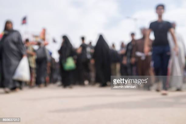 crowded pilgrims walking together - iranian culture stock photos and pictures