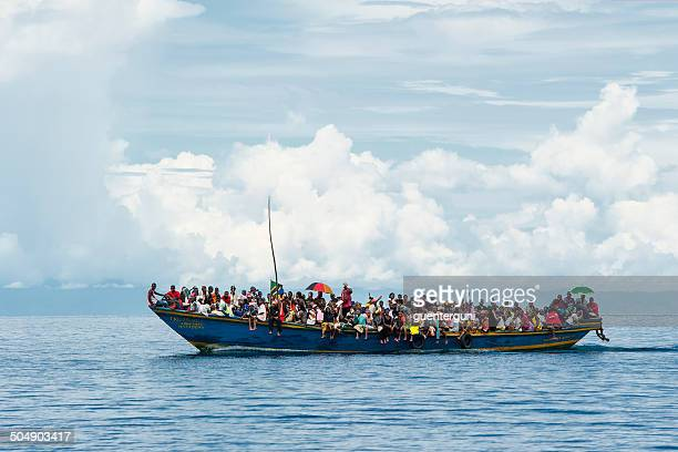 crowded refugee boat on lake tanganyika - watervaartuig stockfoto's en -beelden