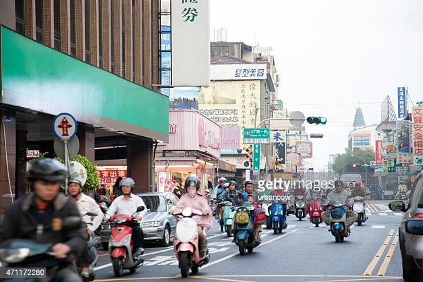 crowded scooters on a city street, beimen street, taipei, taiwan - hualien county stock pictures, royalty-free photos & images