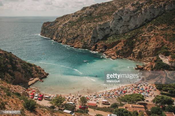 crowded small beach - alicante stock pictures, royalty-free photos & images