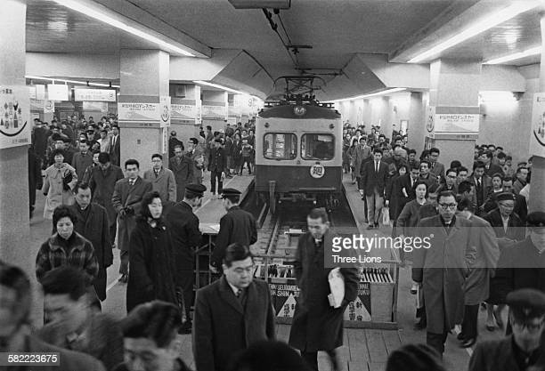 A crowded station at the end of a line in Tokyo Japan circa 1955
