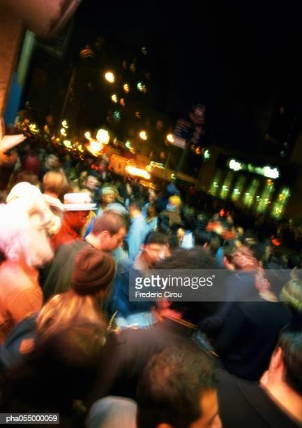 Crowded street at night, blurred