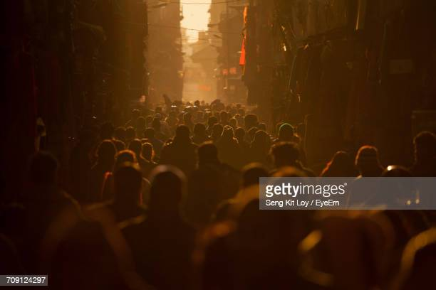 Crowded Street At Sunset