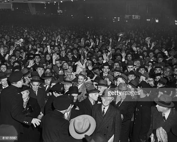 A crowded street in America circa 1938