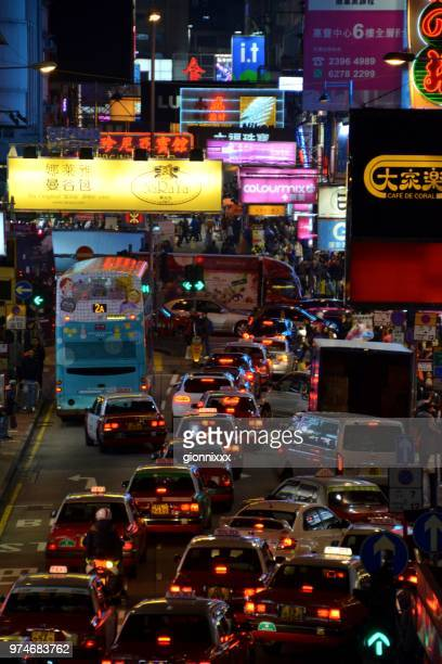 Crowded street in Mong Kok district by night, Hong Kong