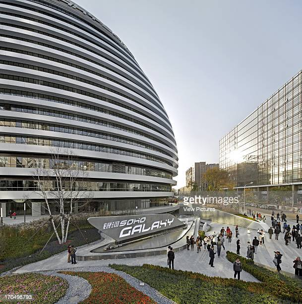 Crowded street scene with dome Galaxy Soho Beijing China Architect Zaha Hadid Architects 2012