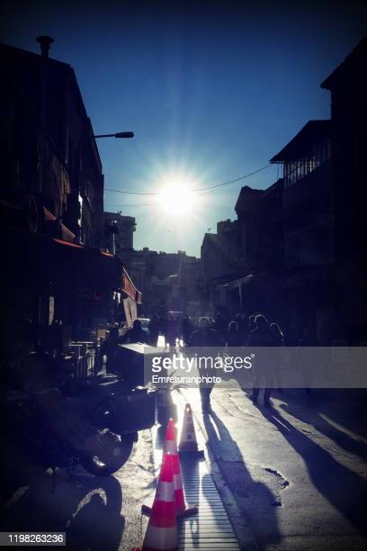 crowded street with shadows at sunset in kemeralti. - emreturanphoto stock pictures, royalty-free photos & images