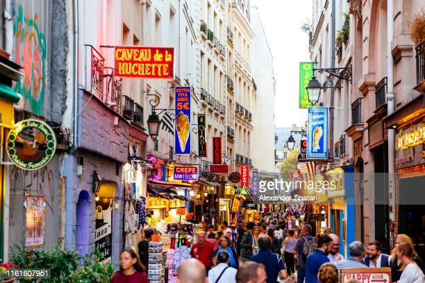Crowded streets with restaurants in Saint Germain district in Paris, France