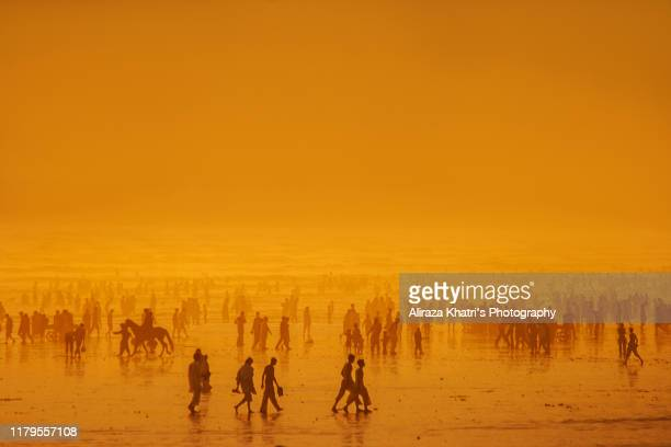 crowded sunset silhouette - global warming stock pictures, royalty-free photos & images