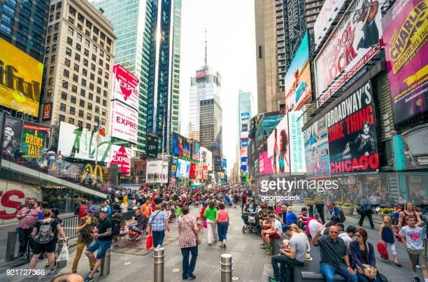 crowded times square, new york city - broadway manhattan stock photos and pictures