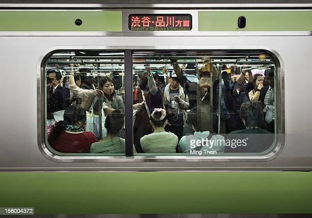Crowded Tokyo Yamanote Line commuter train during a busy period on Saturday when people go out to shop