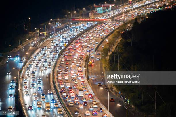 crowded traffic in beijing - traffic stock pictures, royalty-free photos & images