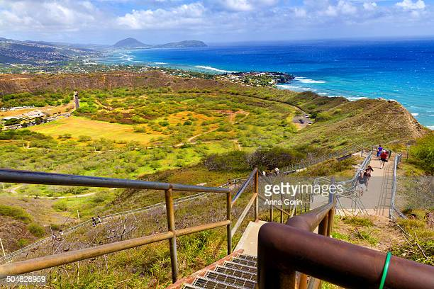 crowded trail to diamond head summit, honolulu - diamond head stock photos and pictures