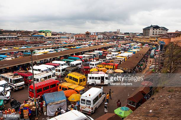 crowded trotro station at central market - ghana ashanti stock pictures, royalty-free photos & images