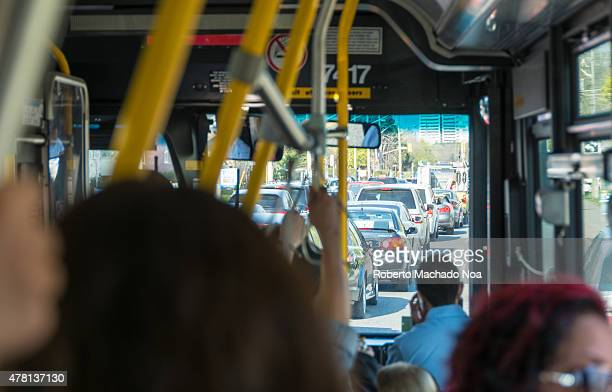 Crowded TTC bus stuck in traffic on busy city street traffic improvements is one of Toronto city government priorities