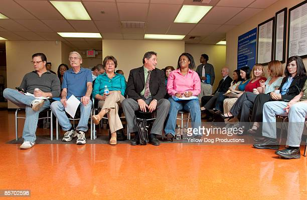 crowded waiting room - waiting room stock pictures, royalty-free photos & images