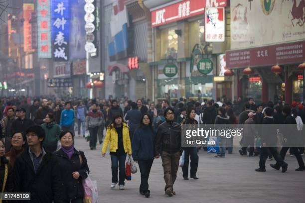 Crowded Wangfujing street and shops in Central Beijing China