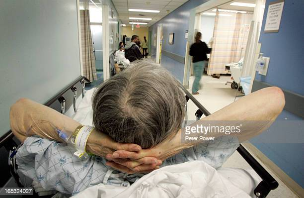 An elderly patient bides her time while waiting on a stretcher in what is know as 'The Hallway' inside of the Sunnybrook Hospital Emergency Room On...